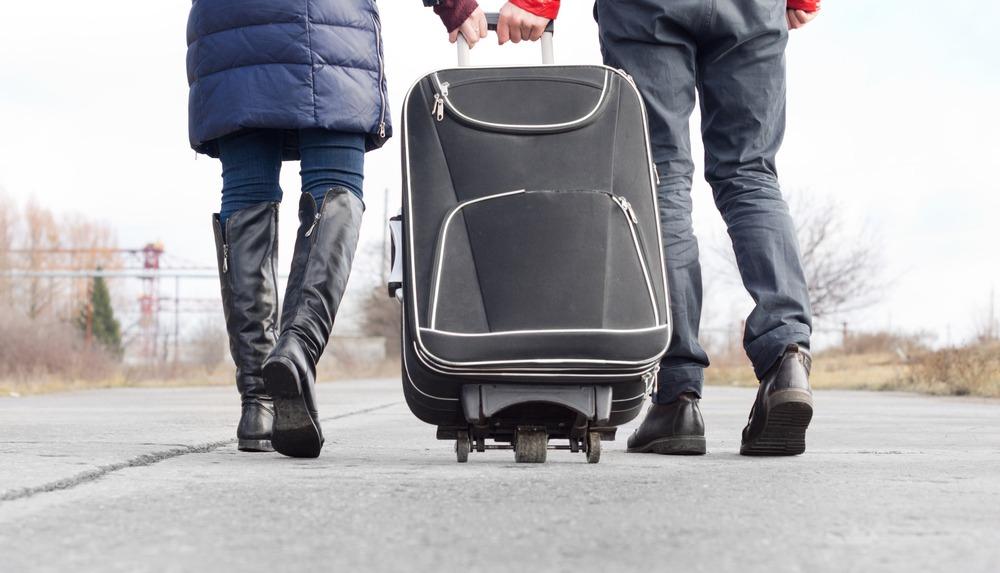 rifugiati politici valigia